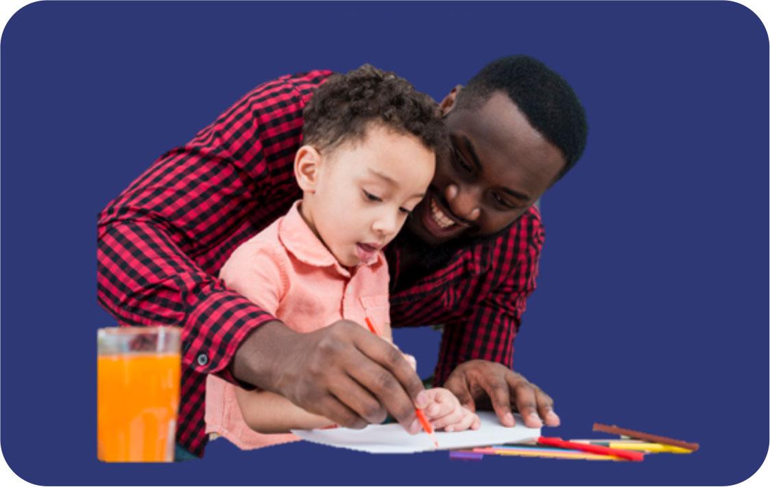 man helping boy with school work