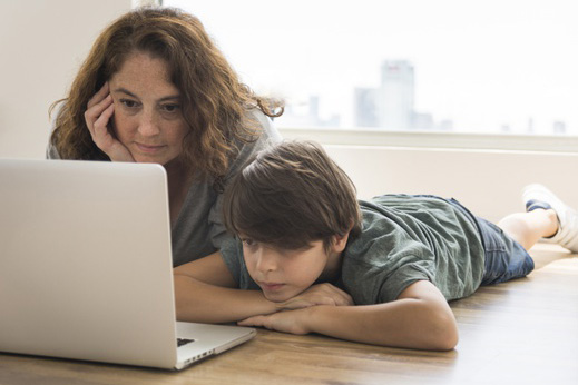 parent and child looking at computer