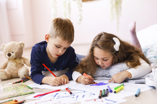 boy and girl colouring