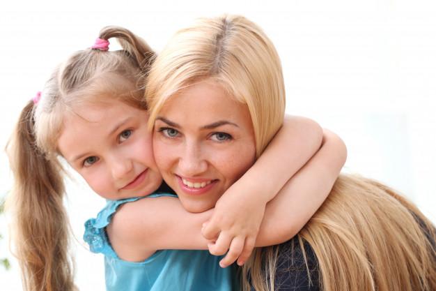 young girl hugging her mum