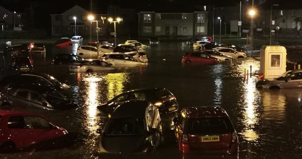 Flooding on the street and submerged cars